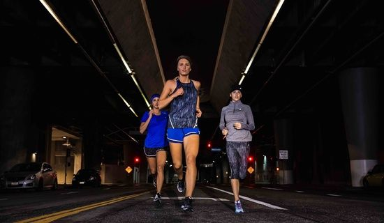 three women running at night; lite-show