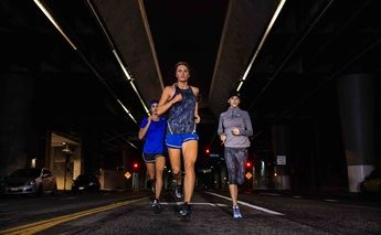 three women running at night; lite-show