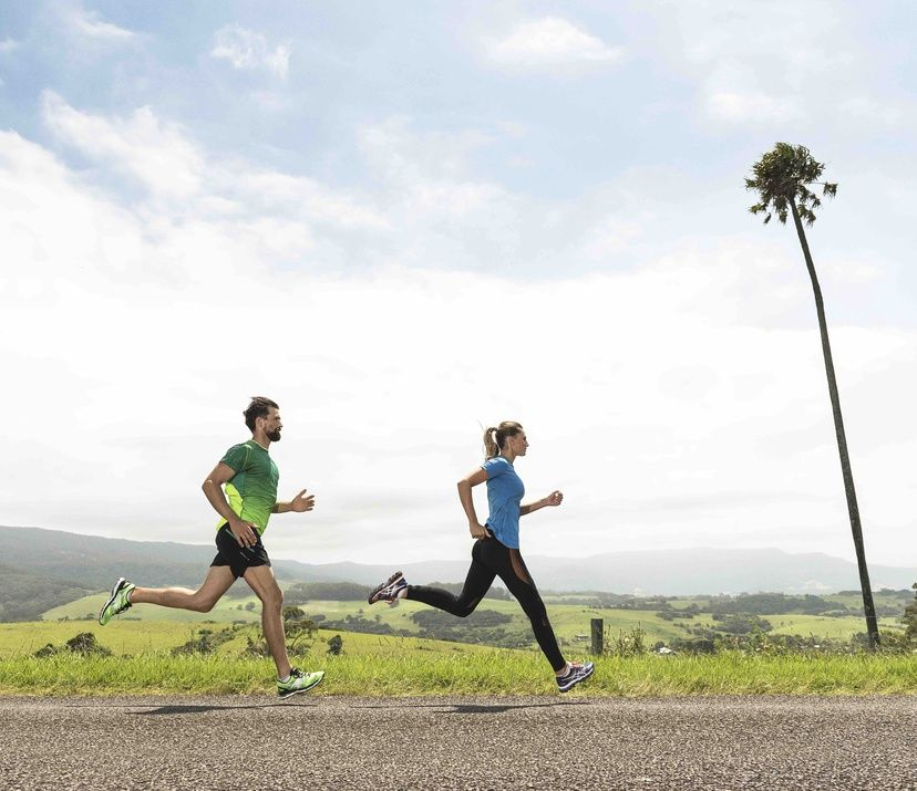 man & woman running; man in green; woman in blue