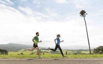 man & woman running; man in green; woman in blue