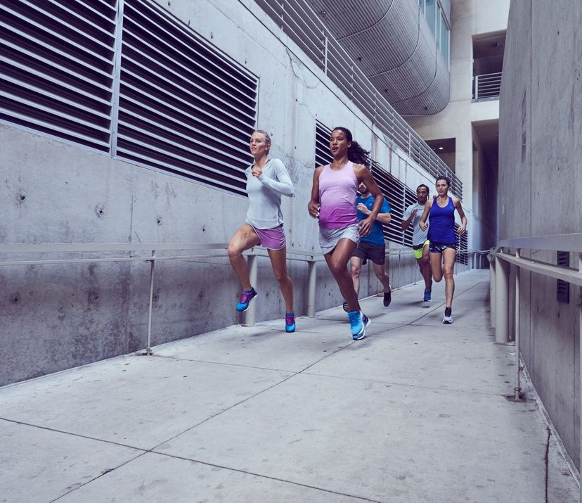 group of runners through cement hallway
