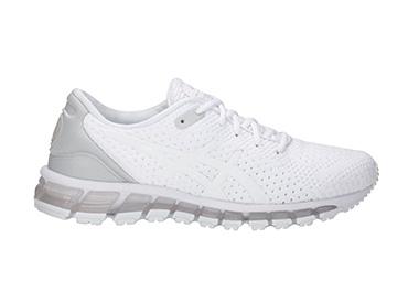 Women's white and silver running shoe.