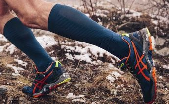 trail running - man's legs & shoes; blue and orange