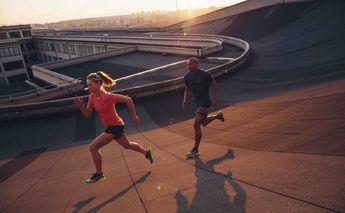 man & woman running in dynaflyte