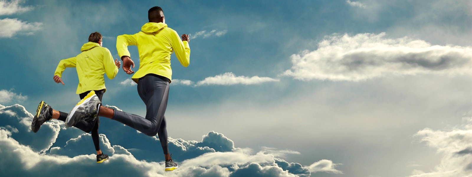 Man and woman in running gear running on clouds.