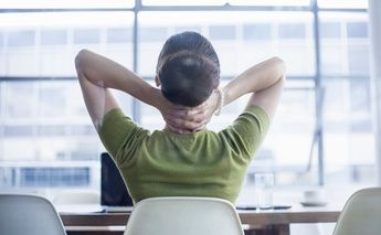 back view of woman at work in desk chair