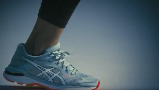 Close up of a woman's running shoe about to push off into a new stride