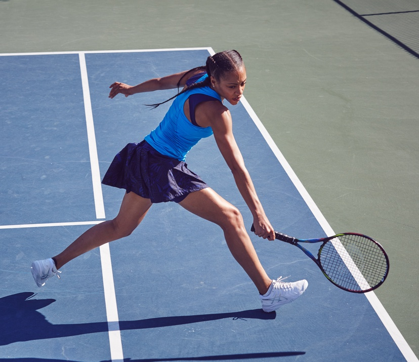 woman in blue playing tennis