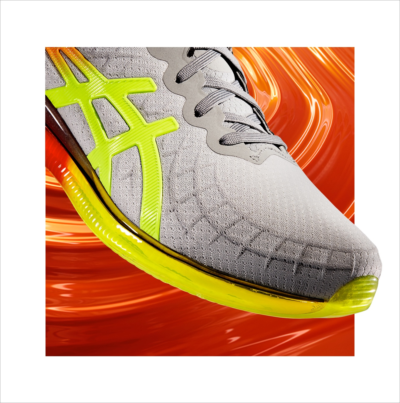 yellow and grey quantum infinity shoe on top of an orange gel background