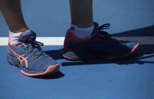 Shoes on a tennis court