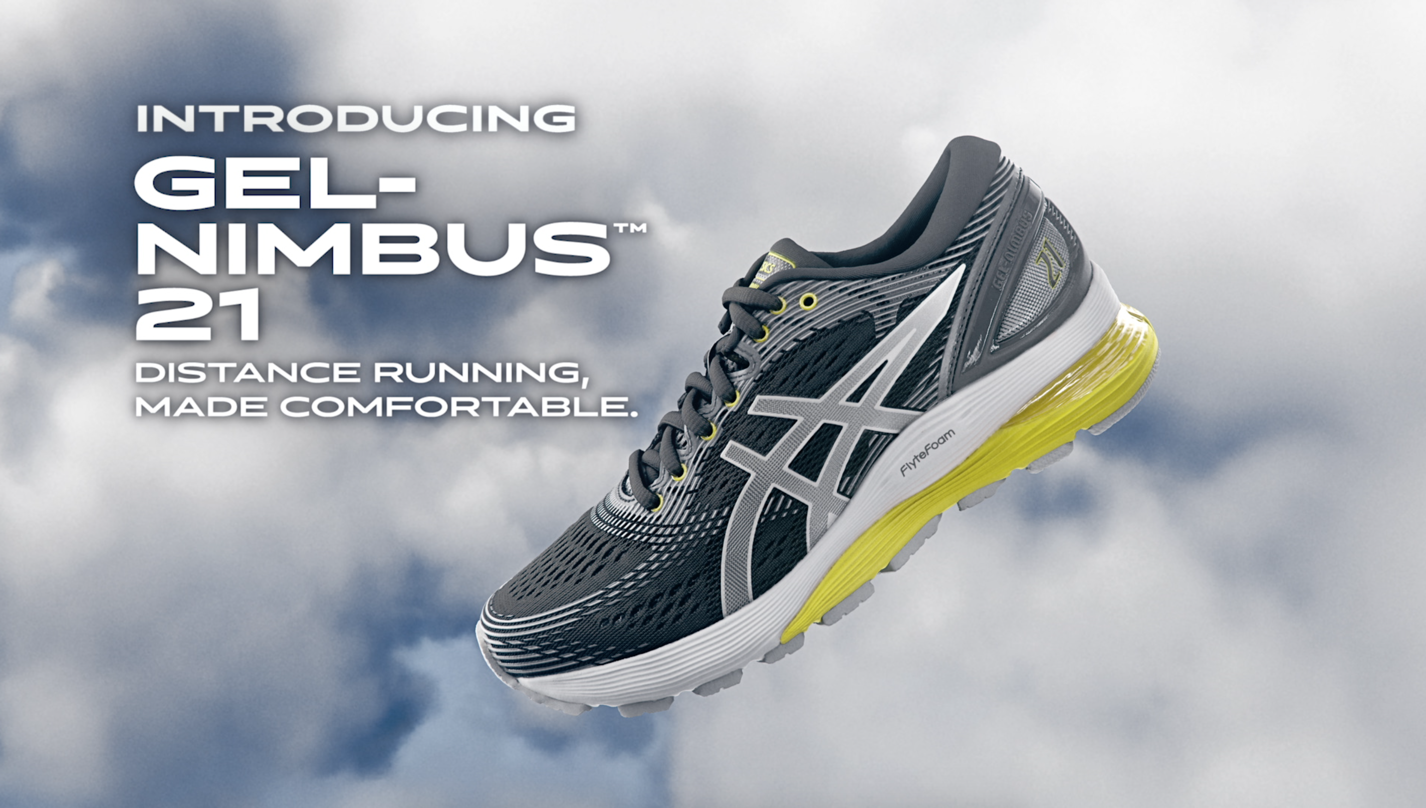 Gel Nimbus 21, Distance Running Made Comfortable. Grey and yellow tennis shoe on top of clouds.