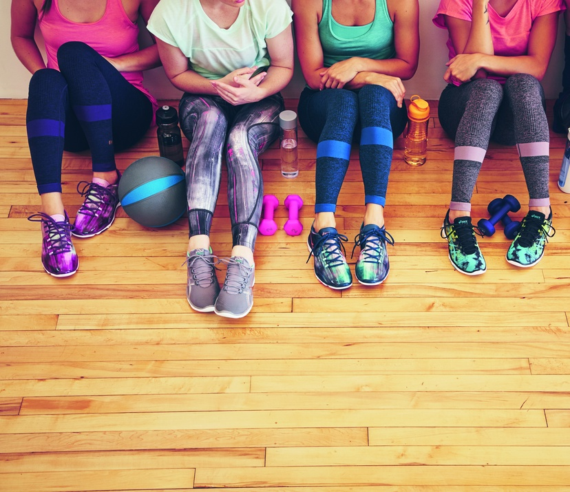 how to start running and develop a training plan - 4 girls sitting on the floor with their ASICS shoes