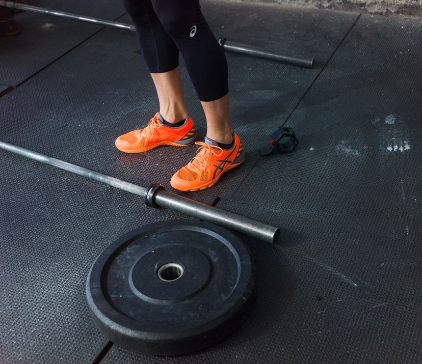 male orange conviction x shoes in gym