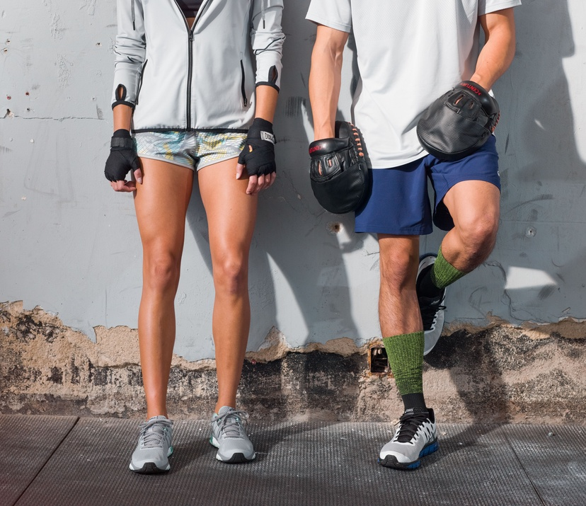pros and cons of training boot camp - a man and woman standing against a wall