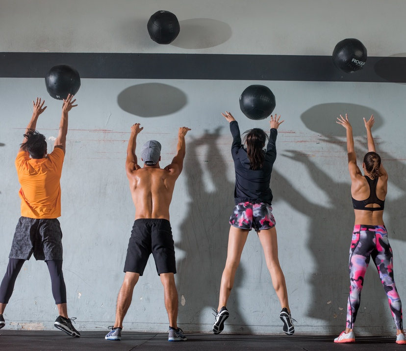 cross training for runners a complete gym workout - group training in gym with medicine balls