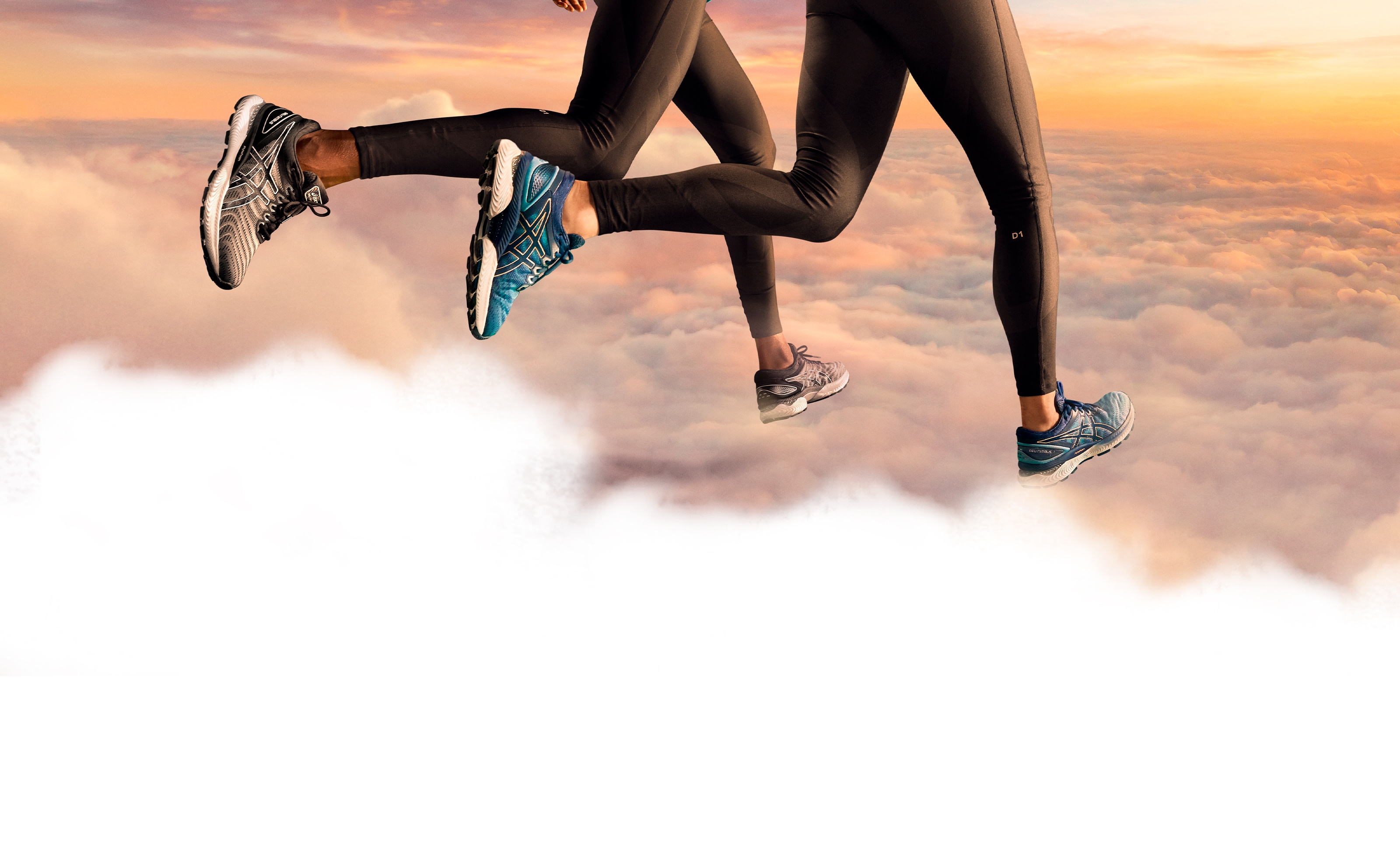 Man and woman running through clouds.