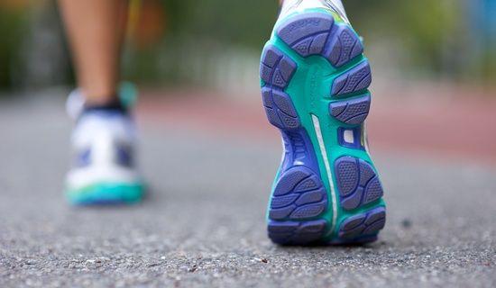 puple & teal bottom of shoes; model running/walking