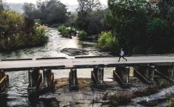Trail running over a river in South Africa