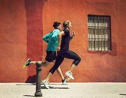Man and woman running outside.