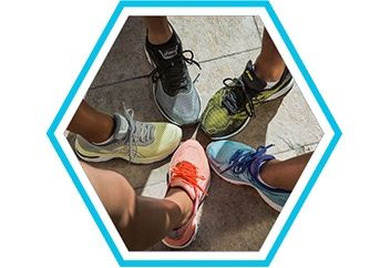 Close up of runners' feet in a circle.