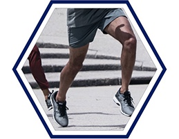 Closeup of a man's running legs.