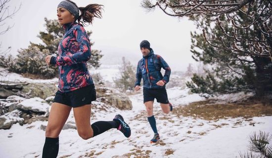 man and woman trail running; winter & snow