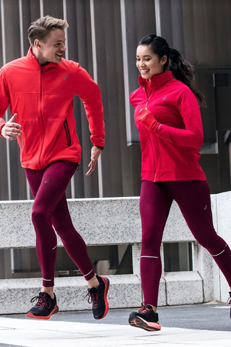 A man and a woman running wearing ASICS DynaFlyte shoes