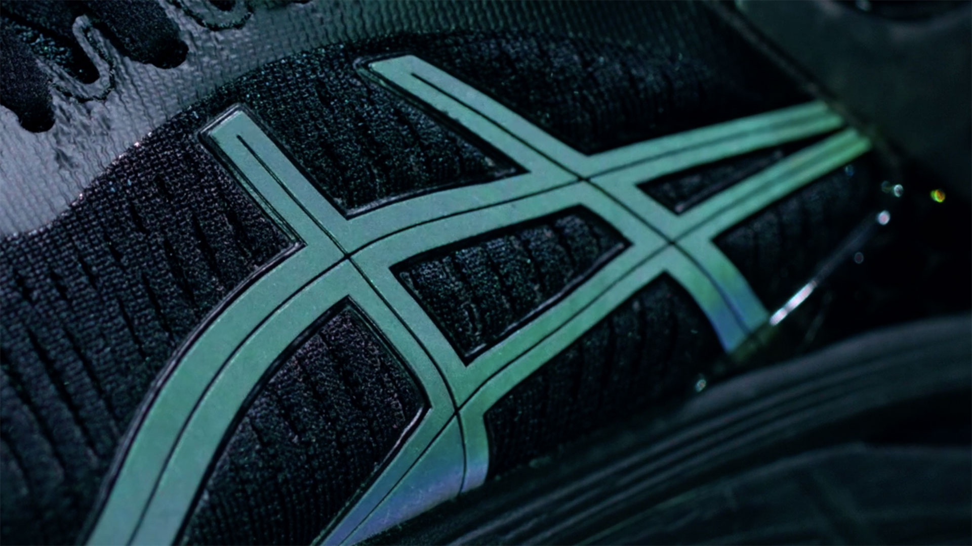 ASICS logo in reflective Lite-show technology